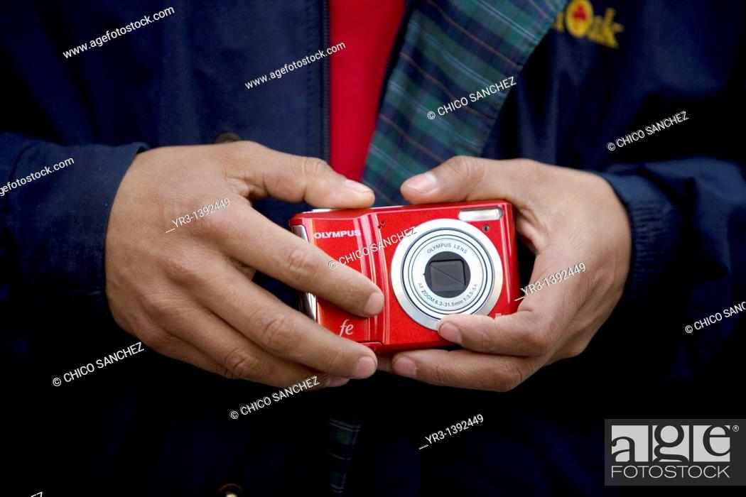 Stock Photo: A blind female student touches a camera.