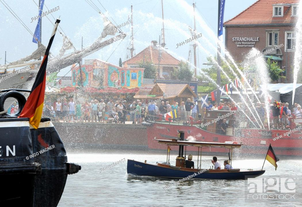 Stock Photo: The sixty year old fire boat shoots high streams of water during the 40th Fest Week in Bremerhaven, Germany, 26 July 2014.