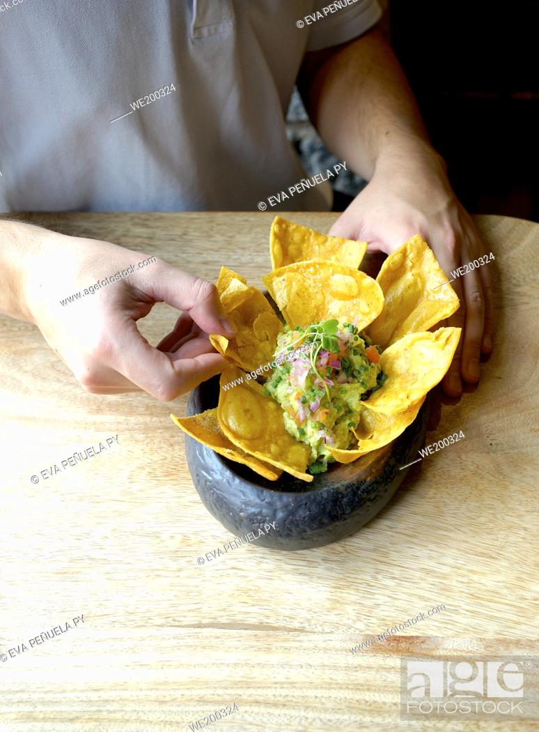 Stock Photo: Eating guacamole in a restaurant.