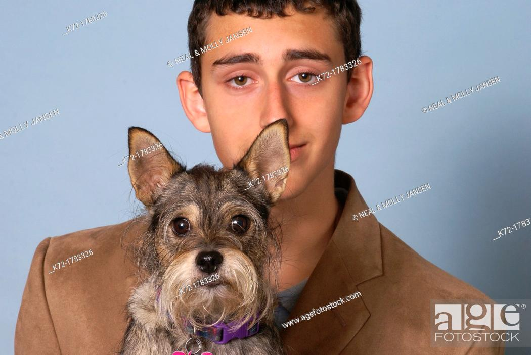 Stock Photo: Funny portrait of dog and young teenage man.