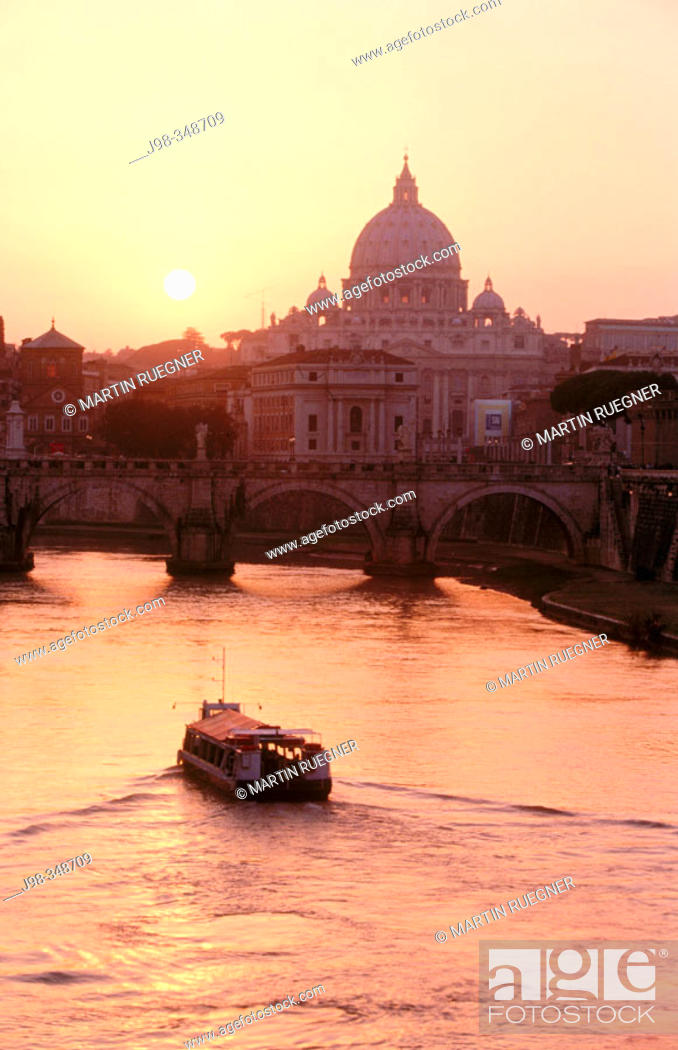 Stock Photo: View on St. Angelo bridge over Tiber river and St. Peter's basilica in background. Vatican City, Rome. Italy.