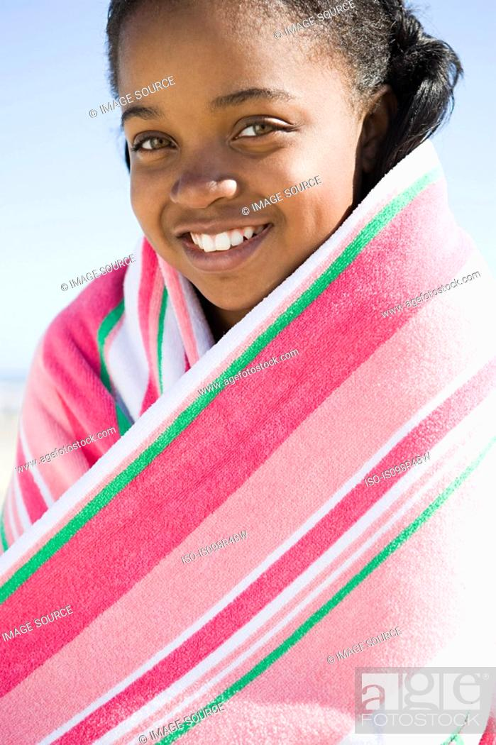 Stock Photo: Tween girl wrapped in a towel.