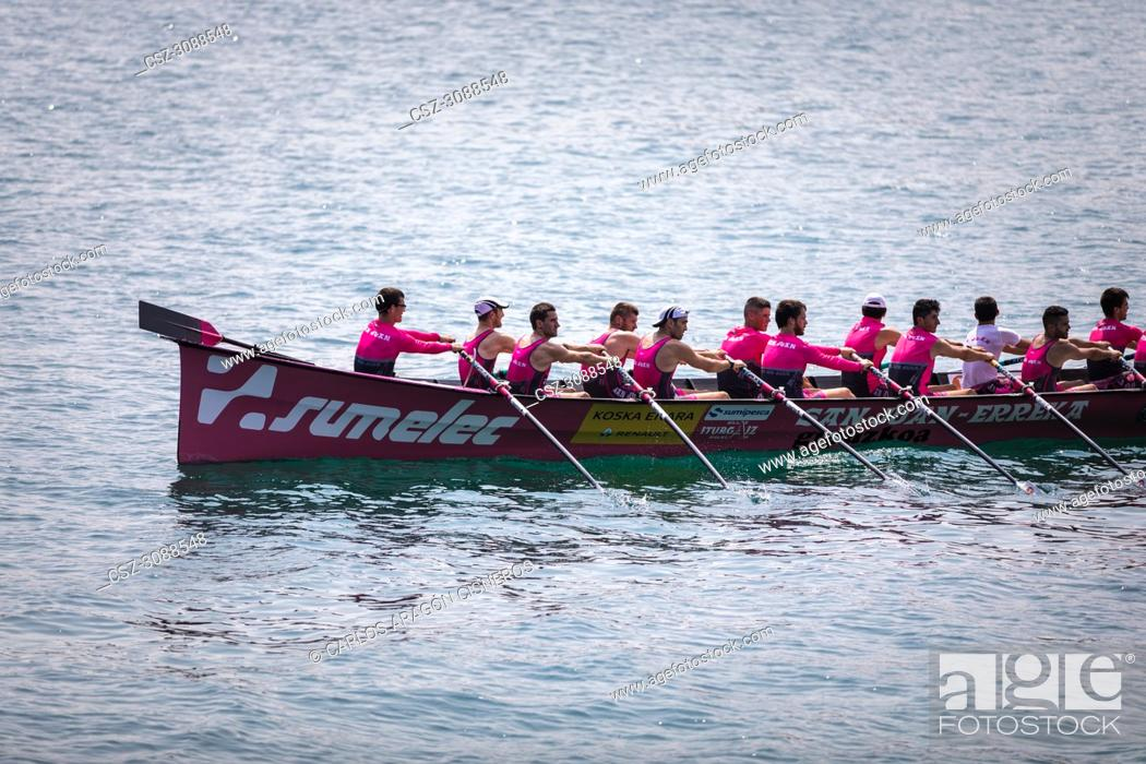 Stock Photo: CASTRO URDIALES, SPAIN - JULY 15, 2018: Competition of boats, regata of trainera, San Juan Sumelec boat in action in the VI Bandera CaixaBank competition.