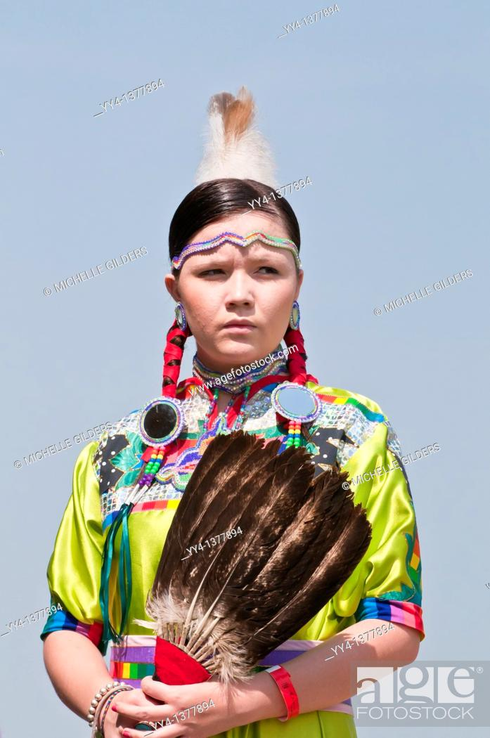 Stock Photo: Female dancer in jingle dance regalia, Pow-wow, Blackfoot Crossing Historical Park, Alberta, Canada.