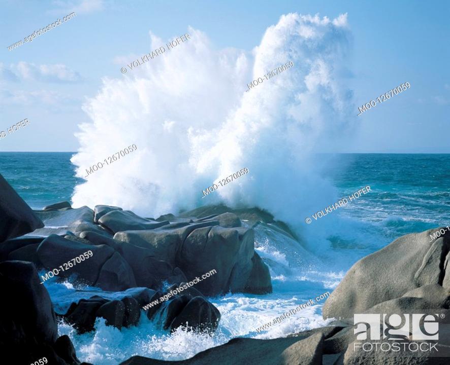 Stock Photo: Waves crashing on rocks at coast.