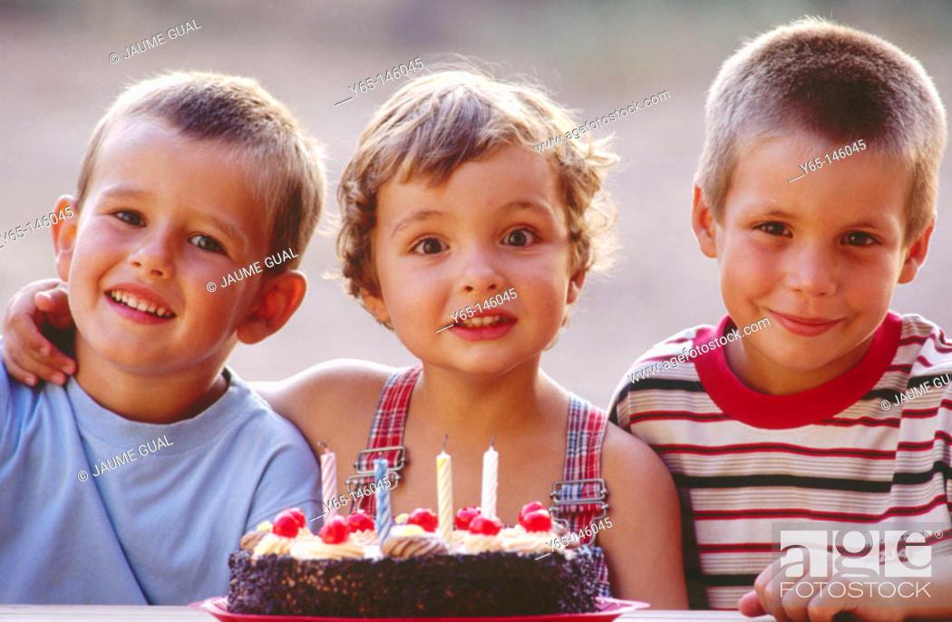 Stock Photo: Children with birthday cake.
