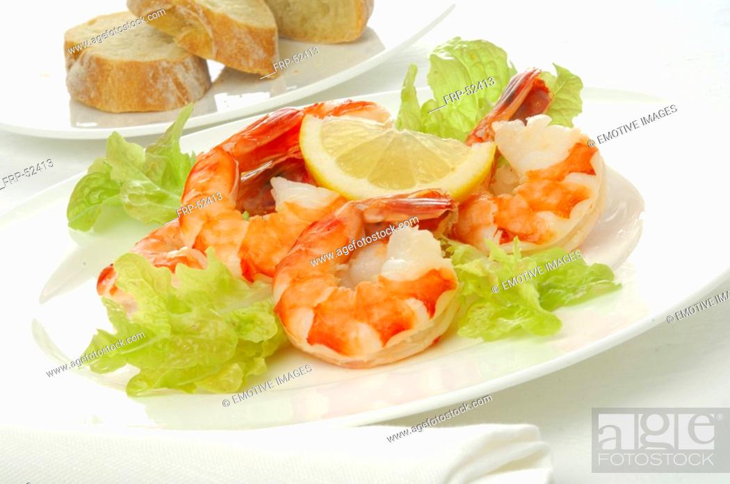 Stock Photo: Shrimps with salad and lemon.