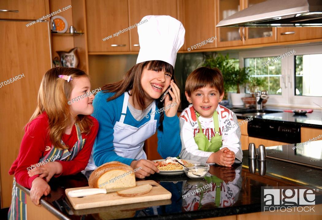 Stock Photo: Children cooking spaghetti.