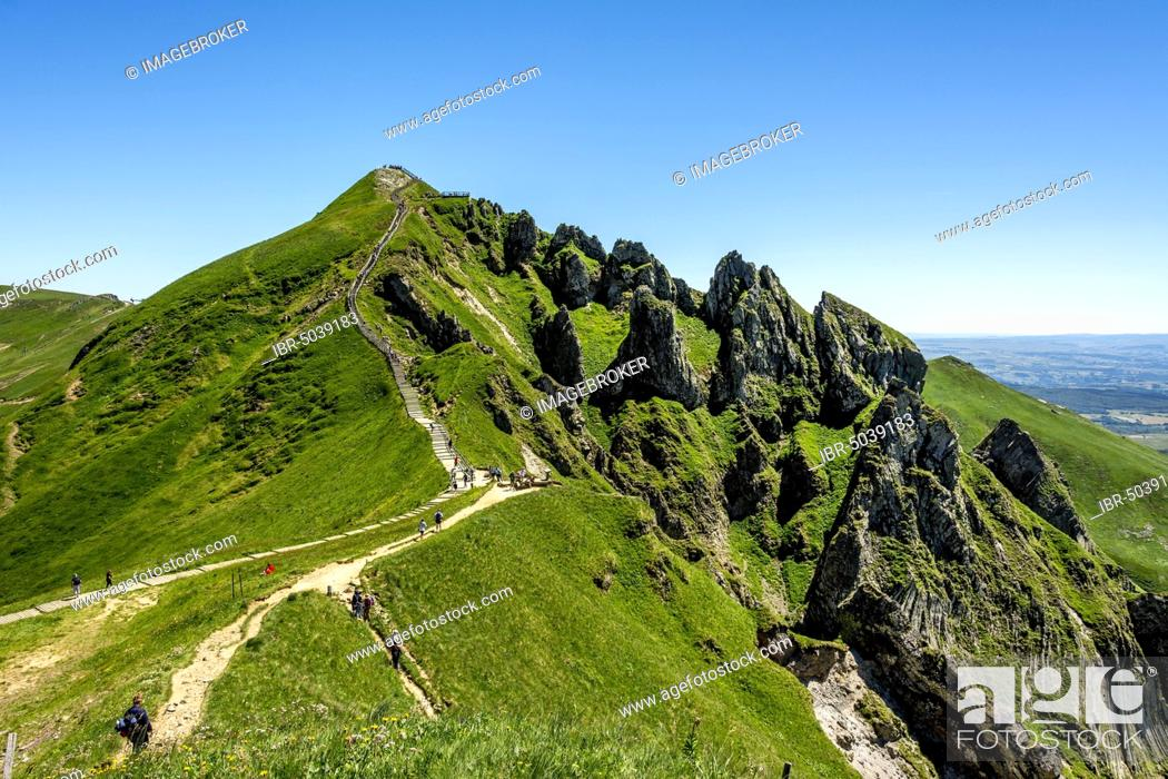 Stock Photo: Hiker on way to Puy de Sancy, Auvergne Volcanoes Natural Regional Park, Massif du Sancy, Auvergne, France, Europe.
