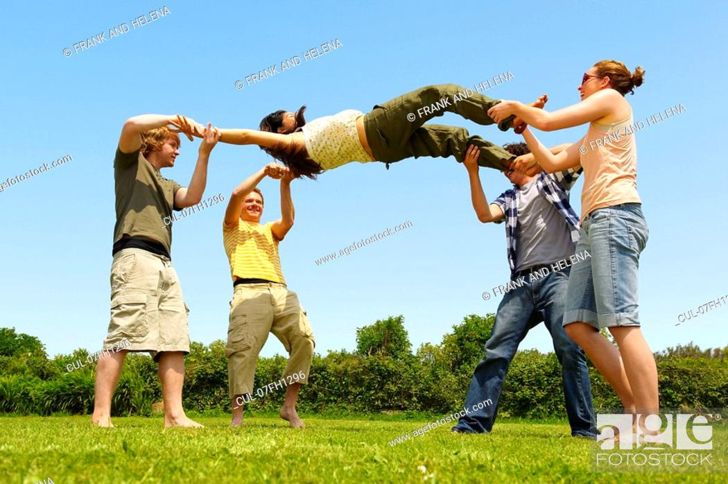 Stock Photo: Group young people playing bumps.