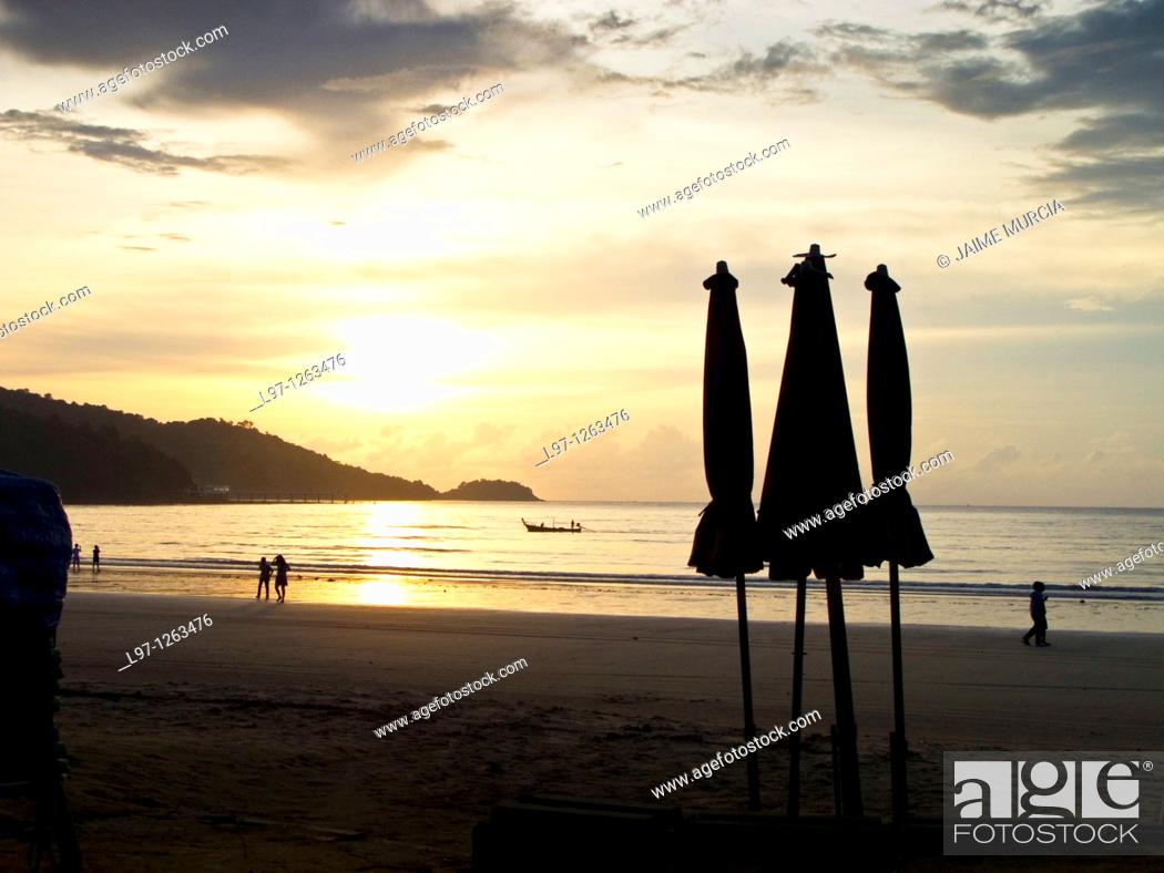 Stock Photo: Silhouette of umbrellas at dusk on Patong beach Phuket, Thailand.
