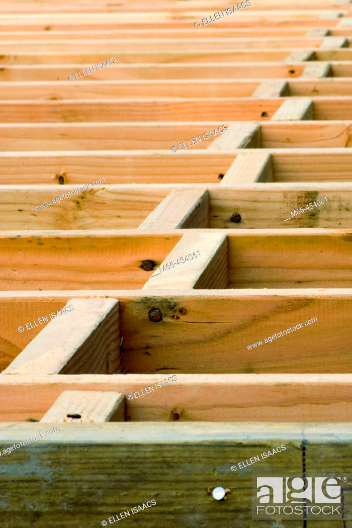 Floor Joists Extending From Rim Joist Into Distance With Wood