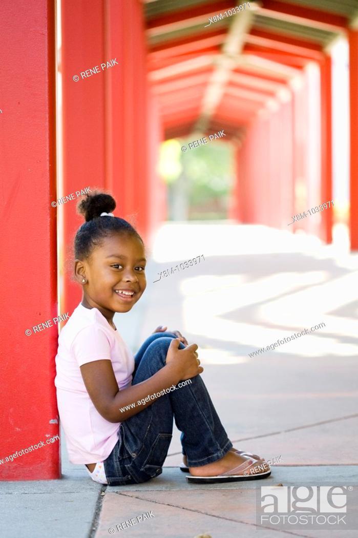 Stock Photo: Smiling little black girl.