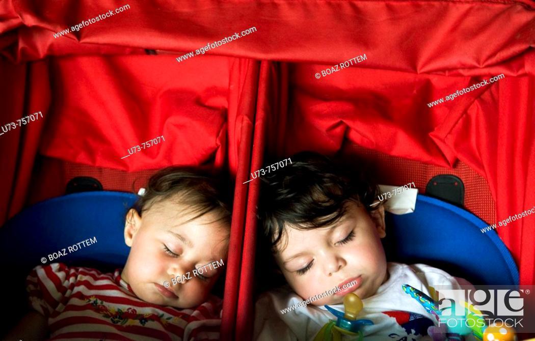 Stock Photo: Cute twins fast asleep.