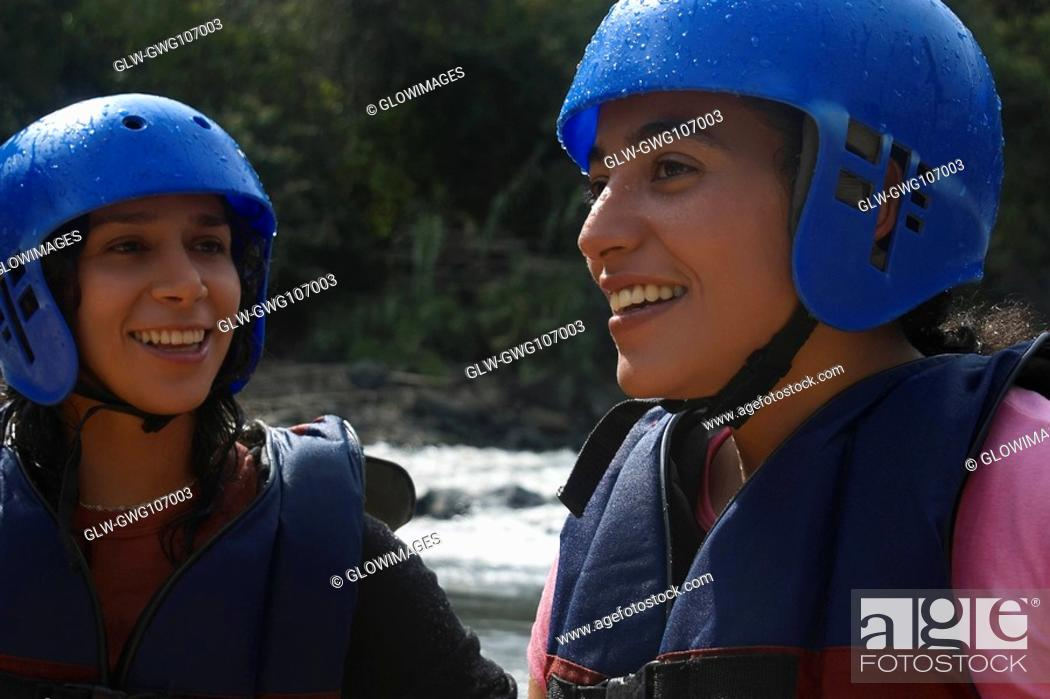 Stock Photo: Close-up of two mid adult women in sports clothing and smiling.
