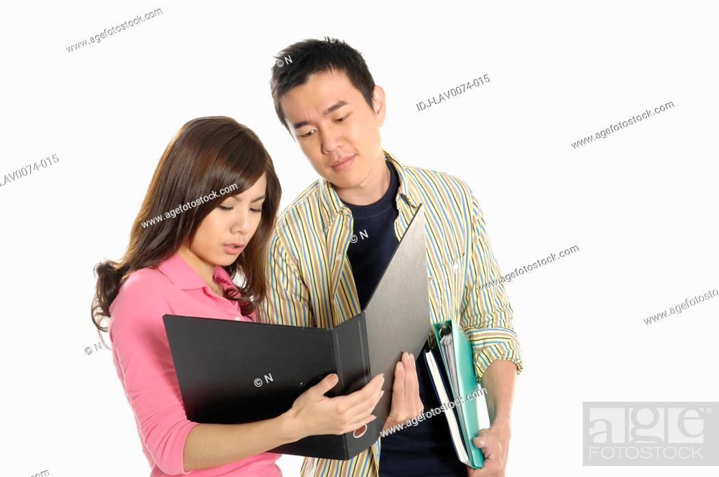 Stock Photo: University students studying together.