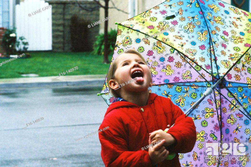 Stock Photo: Catching raindrops.