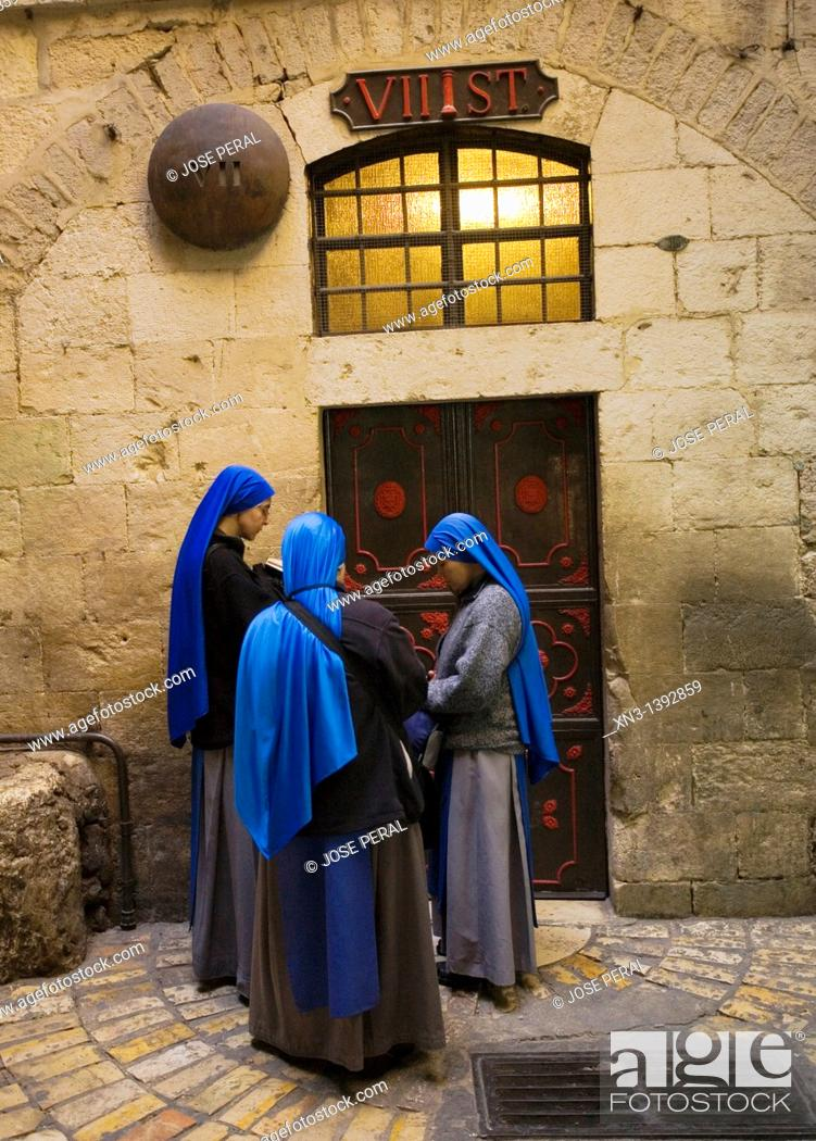 Stock Photo: Nuns praying at the Seventh Stations on the Via Dolorosa, Via Dolorosa, Way of Sorrows, Stations of the Cross, Old City, Jerusalem, Israel.