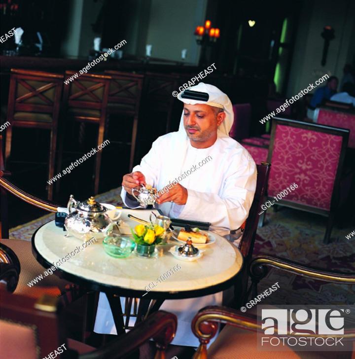 Stock Photo: Arab businessman during coffee break.
