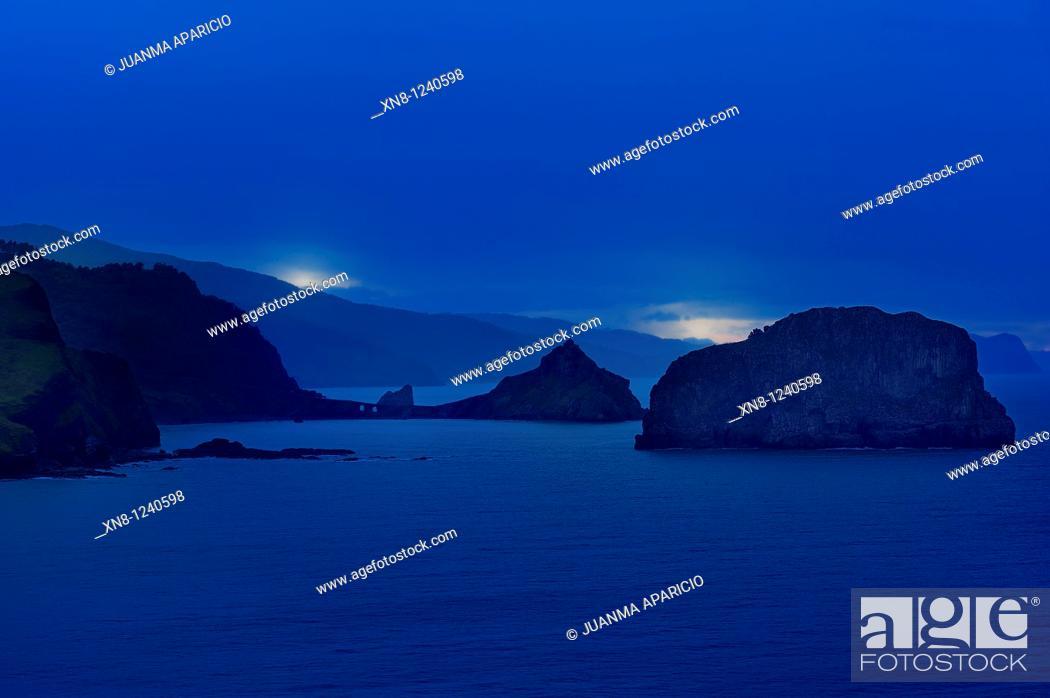 Stock Photo: San Juan de Gaztelugatxe and Arqueche island photographed at sunset from the cape Machichaco on the coast of Bizkaia.