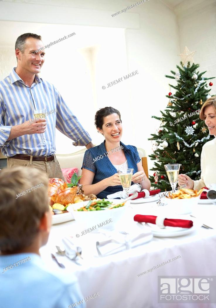 Stock Photo: Family at table at christmas dinner.