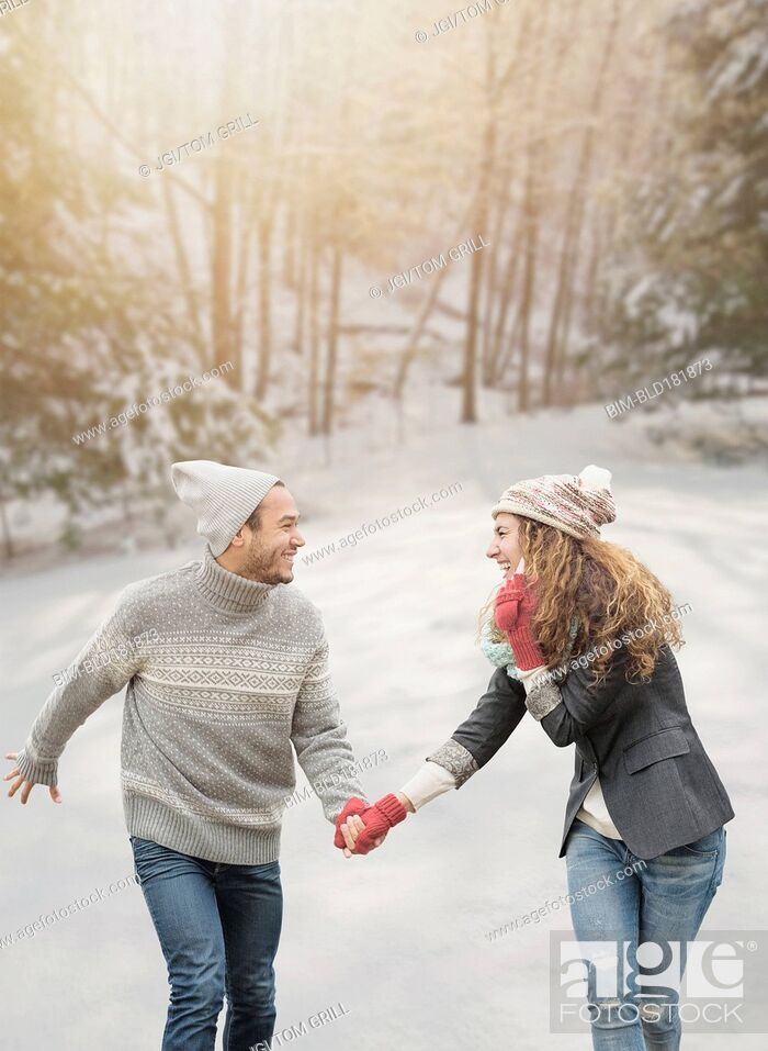 Stock Photo: Couple holding hands in snow.