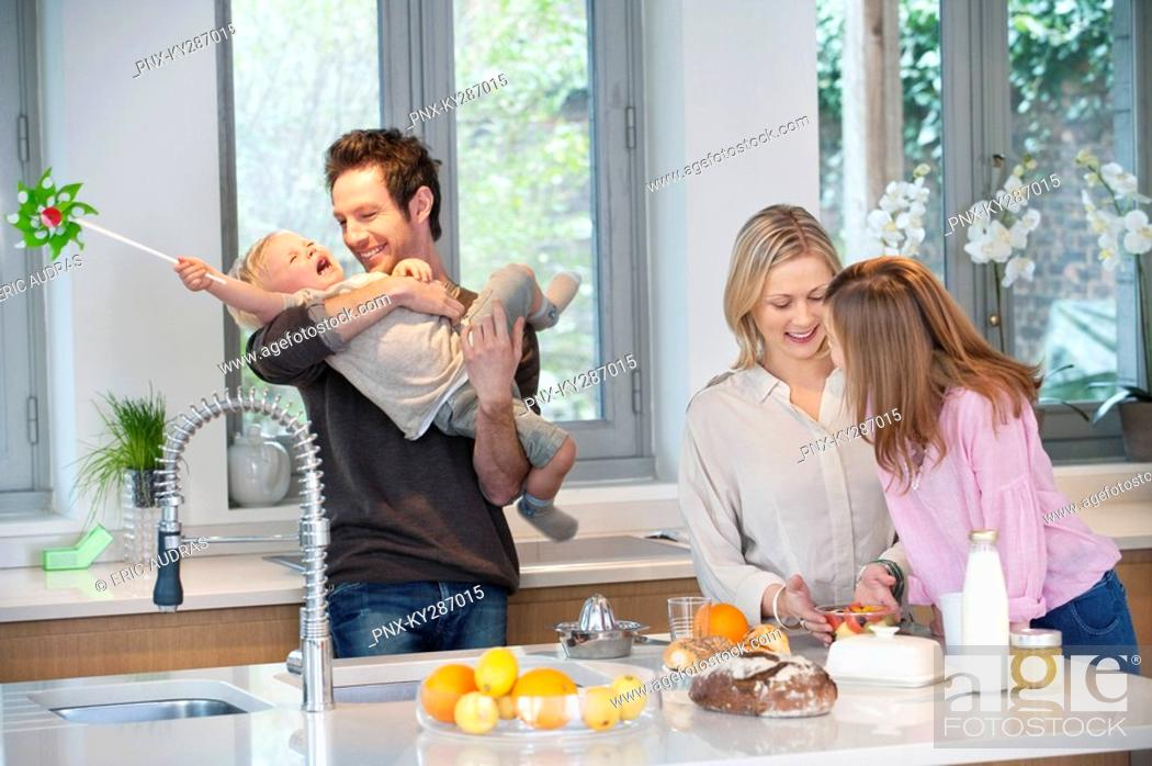 Stock Photo: Family in the kitchen.