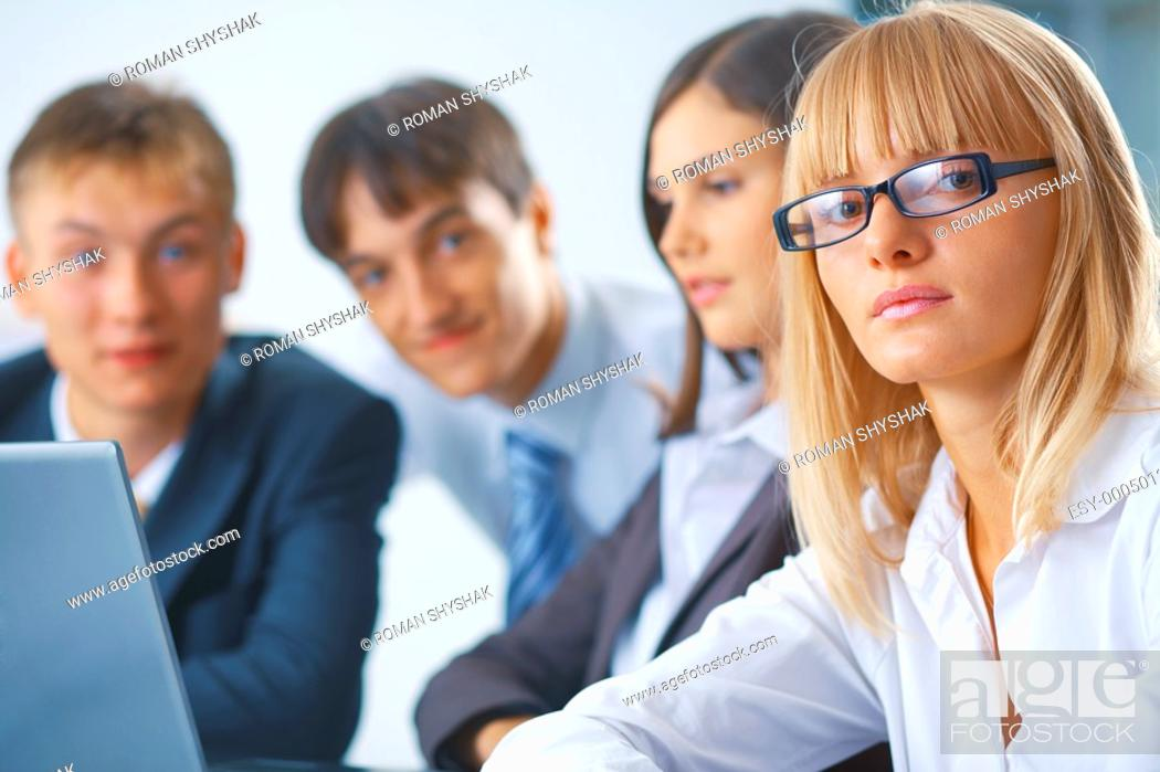 Stock Photo: Portrait of young serious woman with her team.