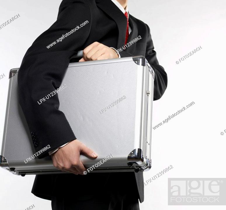 Stock Photo: Businessman Carrying Briefcase.