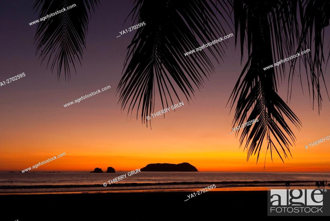 Stock Photo: Costa Rica. Pacific coast, Manuel Antonio, Playa Espadilla beach at sunset, back islas Gemelas.