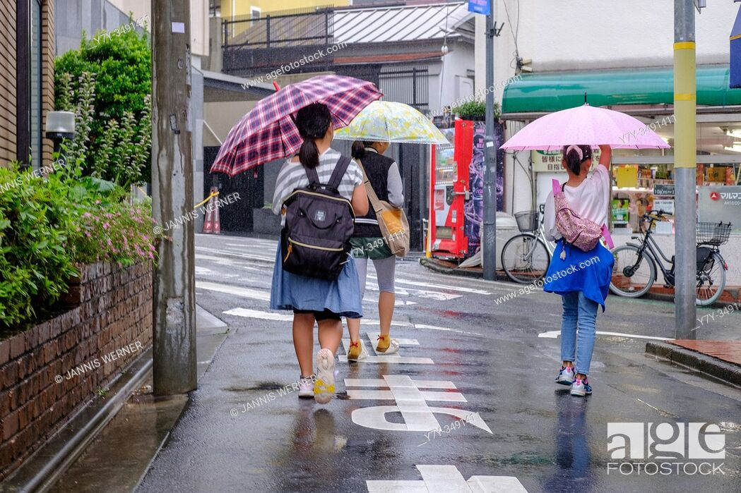 Stock Photo: Scenes from the rainy streets of Tokyo, Japan in summer 2019.