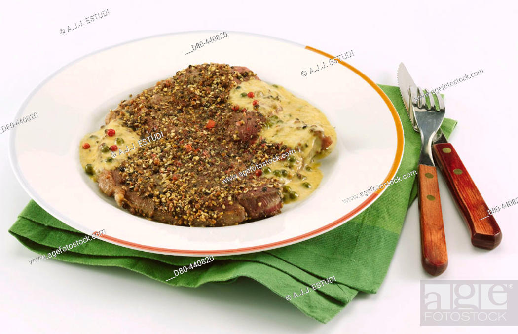 Stock Photo: Steak with tricoloured pepper sauce.