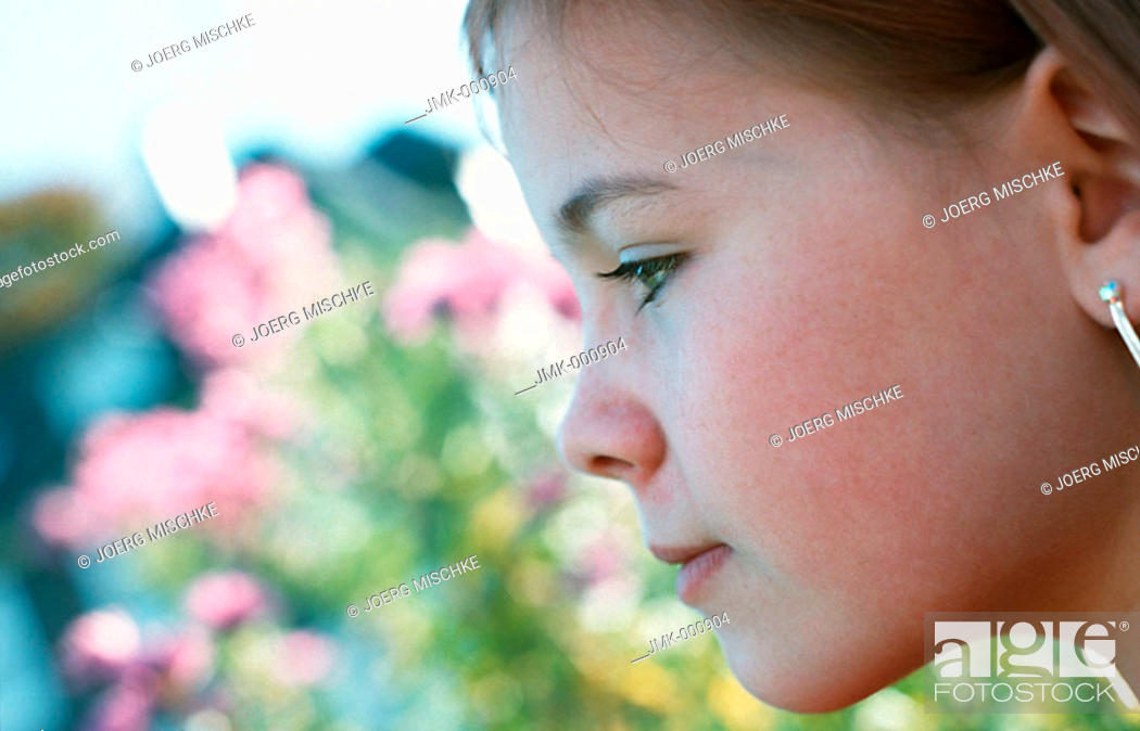 Stock Photo: Portrait of a little girl in the garden.