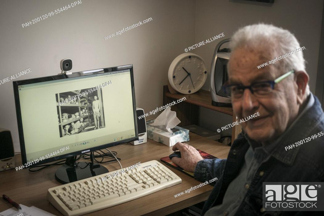 Stock Photo: 20 January 2020, Israel, Haifa: Naftali Fürst, an 87-year-old Holocaust survivor, shows a photo of him and other prisoners in Buchenwald concentration camp on.