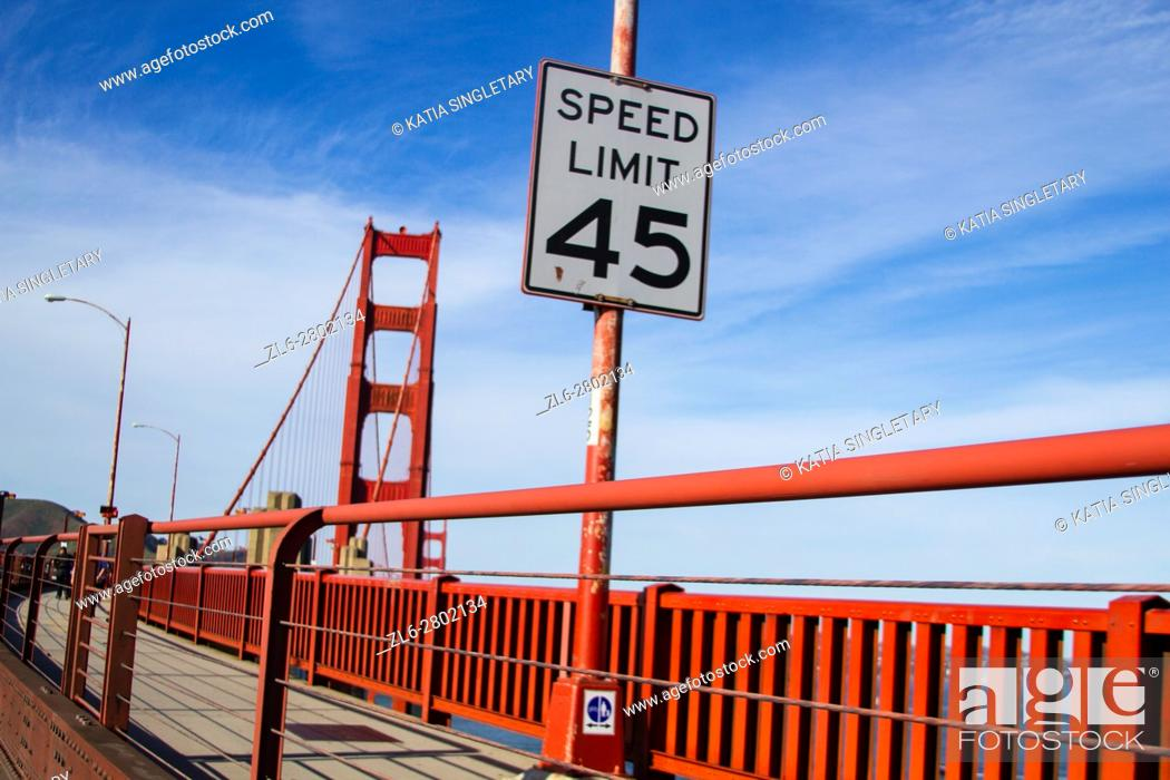 Stock Photo: Speed limit 45 sign on the Sidewalk of the Golden gate bridge in San Francisco on a sunny afternoon, blue sky.