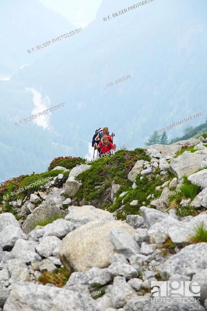 Stock Photo: Two women hiking in Val Bondasca, Bergell, Grisons, Switzerland.