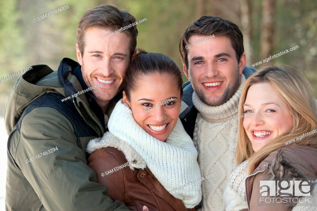Stock Photo: Portrait of smiling couples hugging.