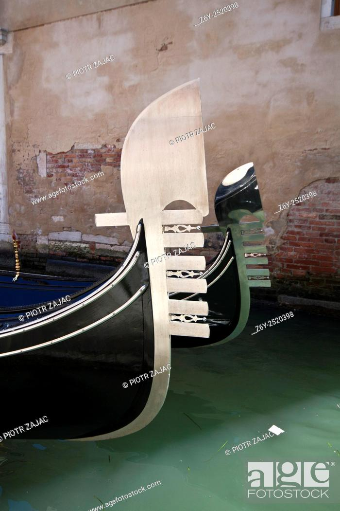 Stock Photo: Iron stern ornaments of gondolas also known as 'risso', or curl in Venice, Italy.