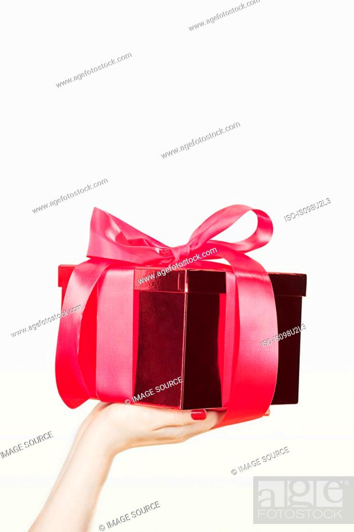 Stock Photo: Young woman offering present.