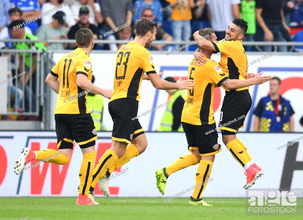 Stock Photo: Dresden's Haris Duljevic (L-R), Florian Ballas, scorer Manuel Konrad and Aias Aosman cheer over the 2-1 score during the German 2.