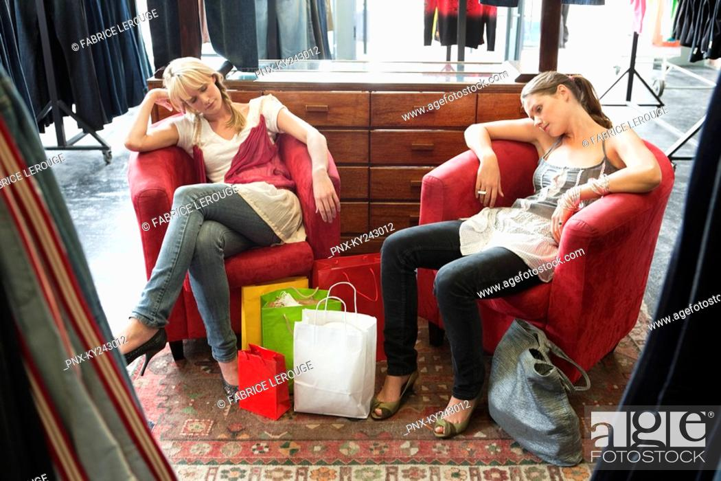 Stock Photo: Two women napping in a boutique.