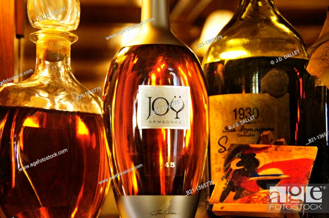 Stock Photo: Old bottles of Armagnac at restaurant Pepito, Manciet, Gers, Midi-Pyrenees, France.
