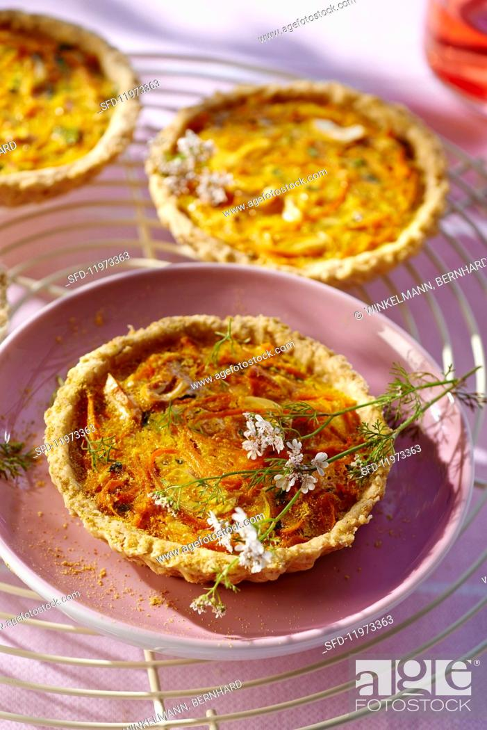 Stock Photo: Carrot tarts with oats and curry.