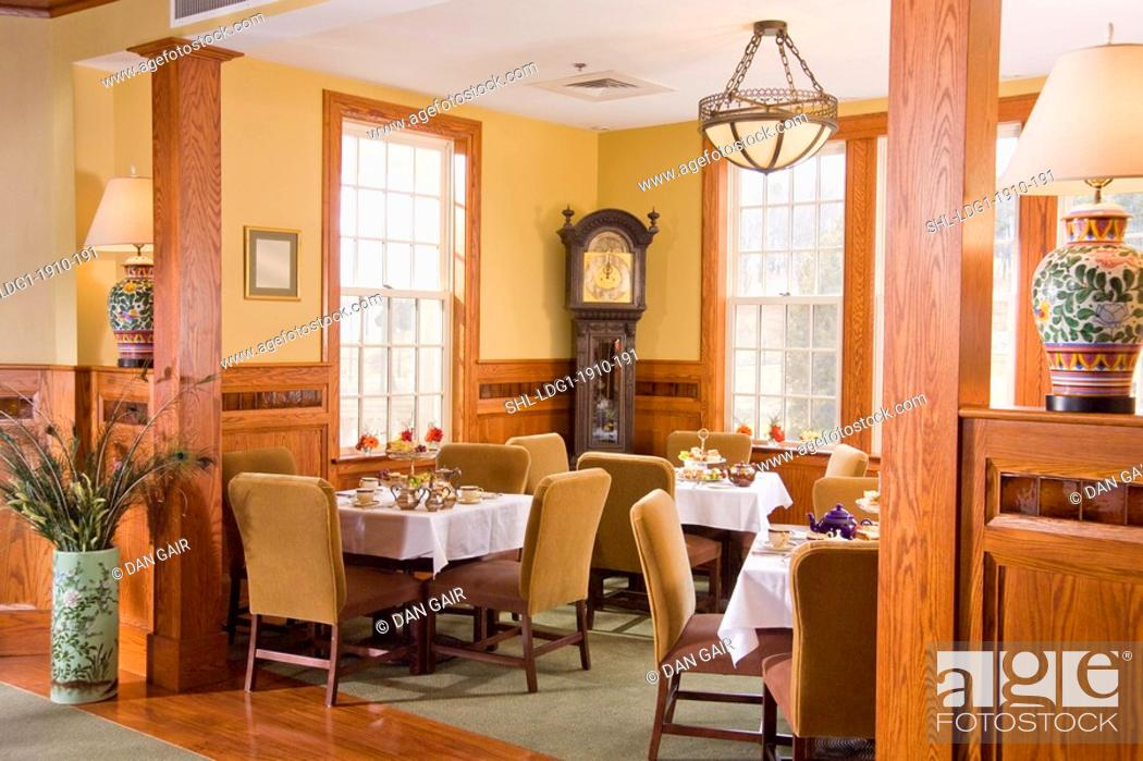 Stock Photo: Dining Room With Multiple Place Settings And Grandfather Clock.