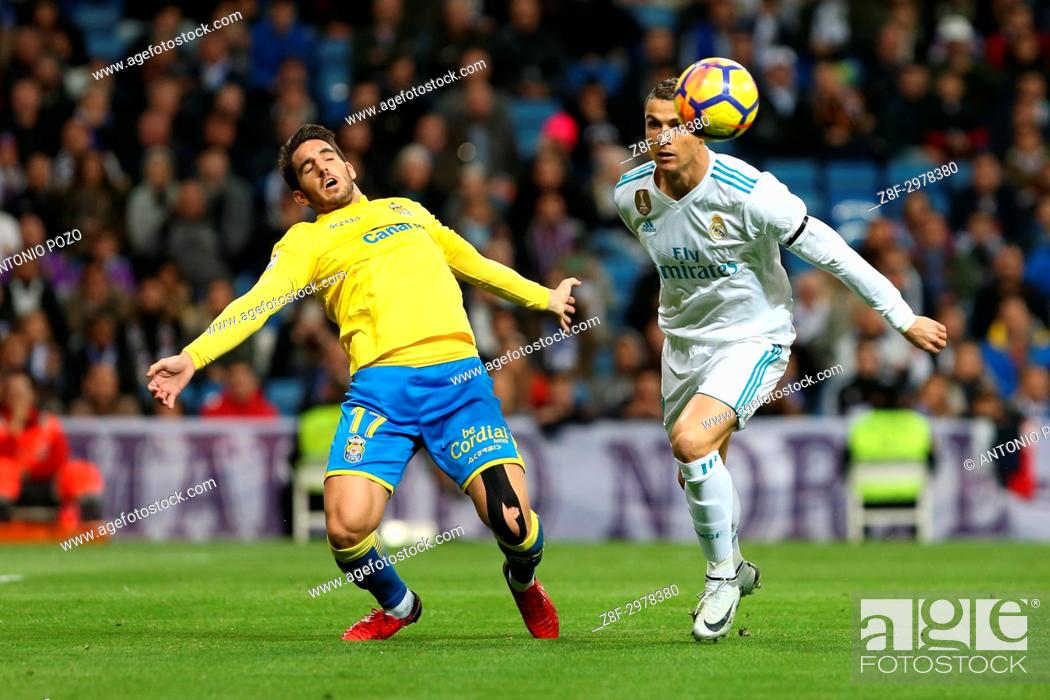 Stock Photo: MADRID, SPAIN. November 05, 2017 - Pedro Bigas and Cristiano Ronaldo. Real Madrid defeated Las Palmas 3-0 with an spectacular goal from Asensio with Casemiro.