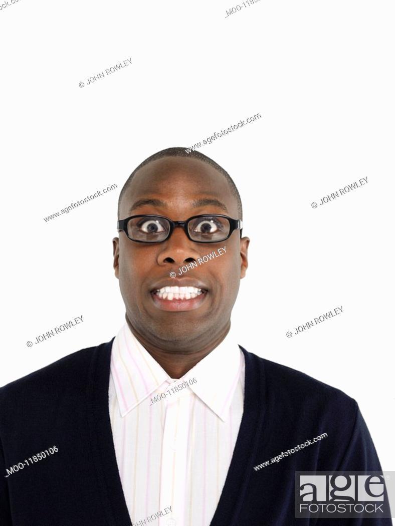 Stock Photo: Man in glasses in studio head and shoulders.