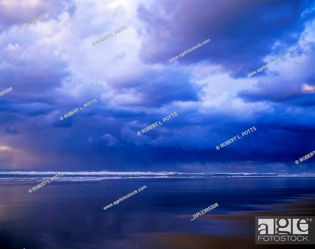 Stock Photo: Storm clouds and a rain shower approach the beach; Winchester Bay, Oregon, United States of America.