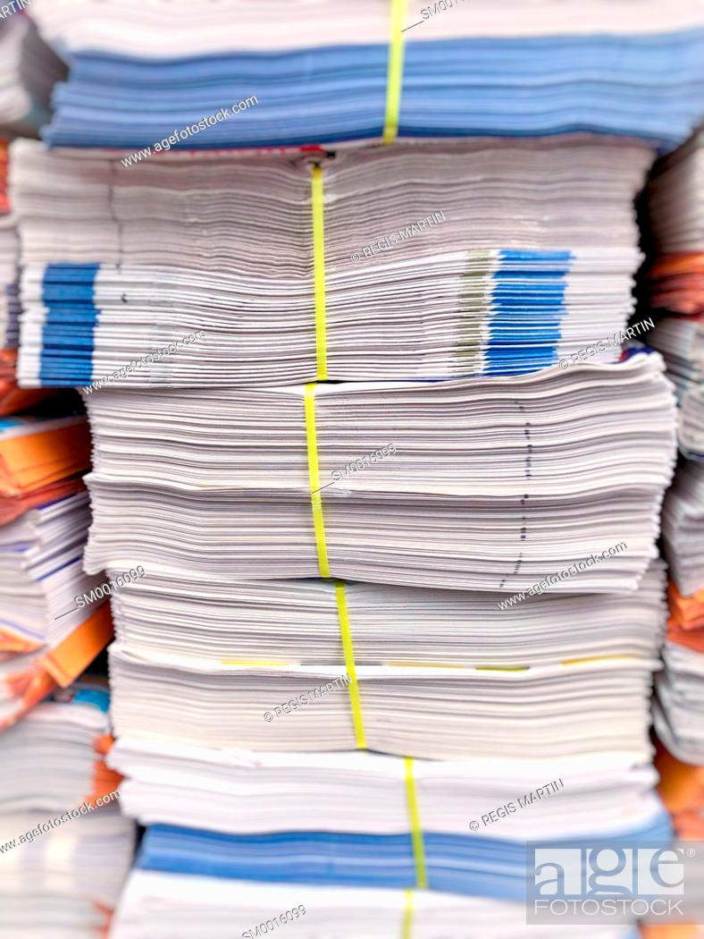 Stock Photo: Stacks of newspaper ready to be delivered.