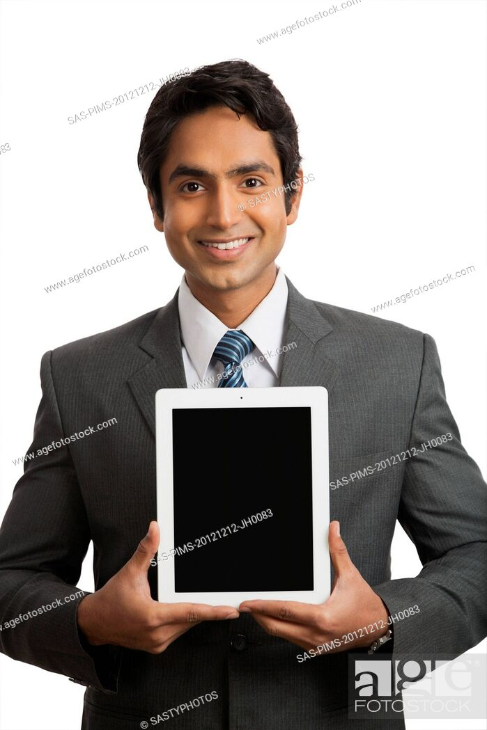 Stock Photo: Portrait of a smiling businessman holding a digital tablet.