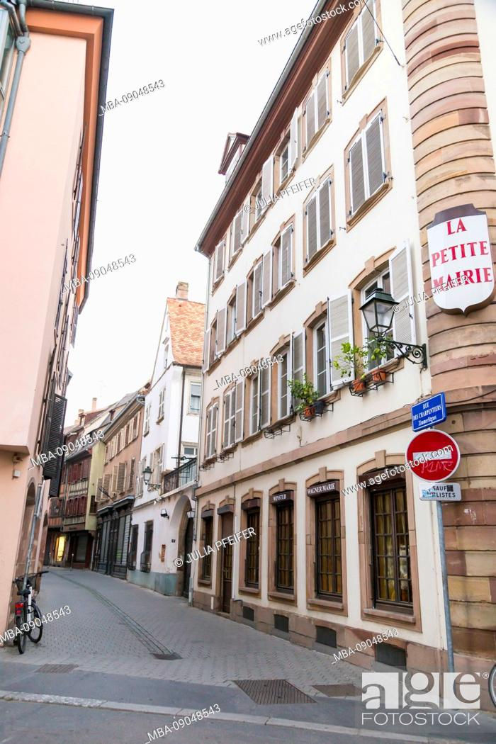 Stock Photo: Narrow street or lane in Strasbourg, Alsace, France lined with quaint historical houses and a no entry sign for traffic with parked bicycle.